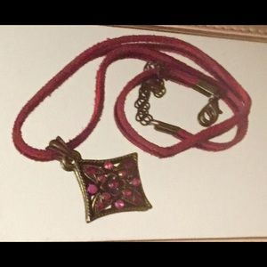 Square vintage pendant on red leather cord